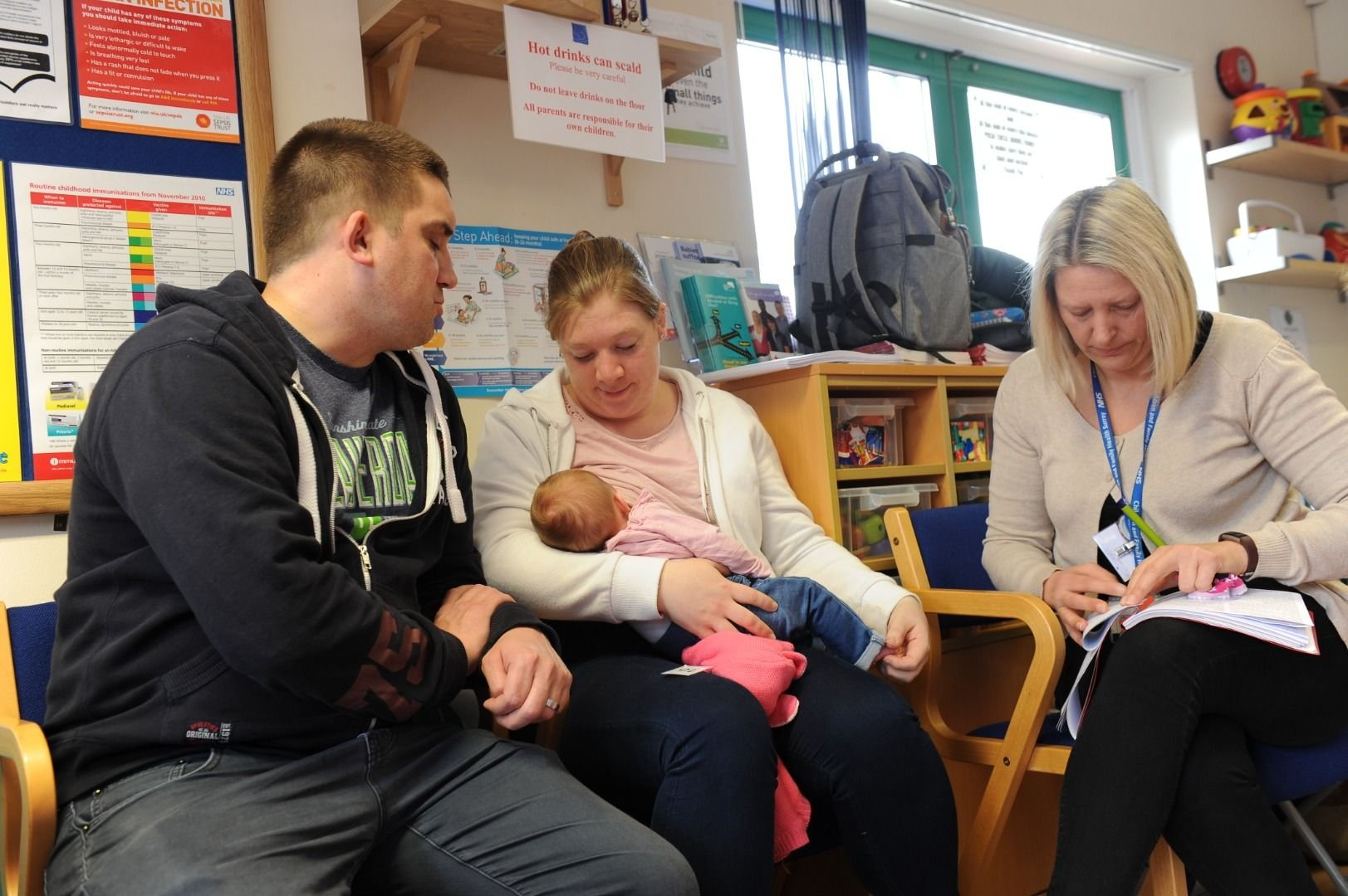 Family at a child health drop-in