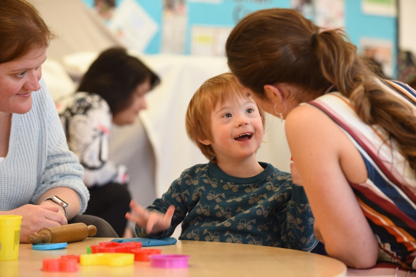 Child looking at Speech and Language Therapist